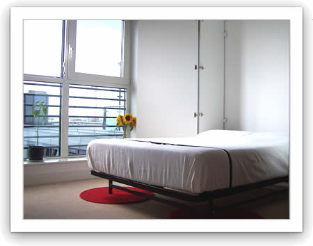 Modern looking living room with a wallbed