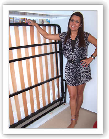 Lady standing by a double horizontal wall bed