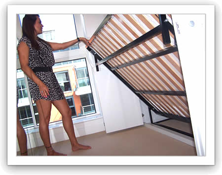 Lady using a double horizontal wall bed