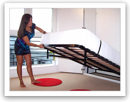 Lady carefully lowering a wall bed down